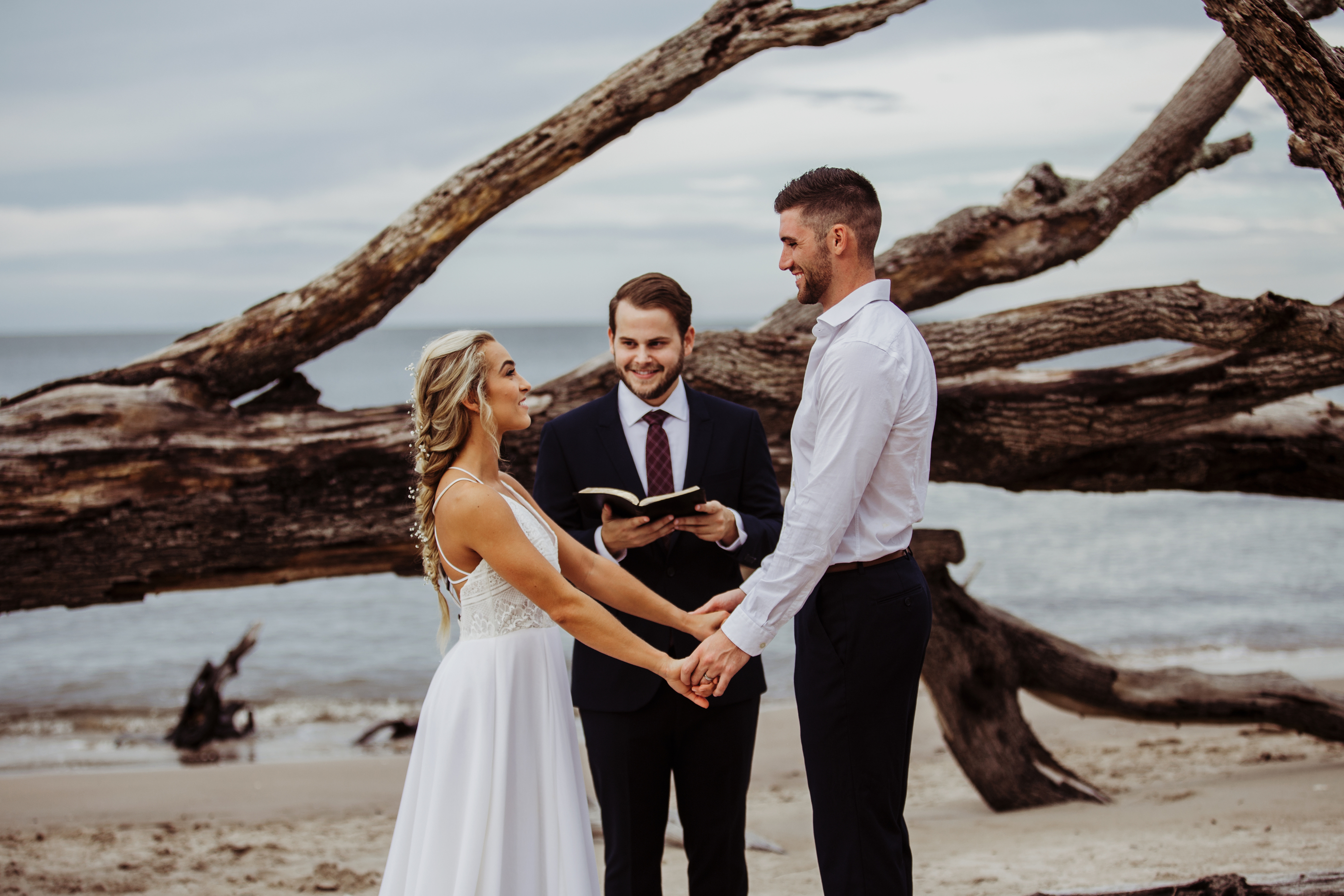 Wedding Photography & Engagement Photography, couple getting married on the beach