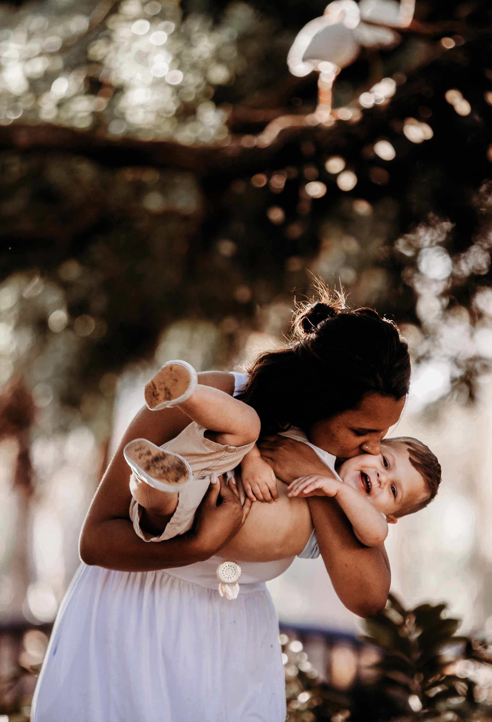 Family Photography and Children Photography, mother kissing child