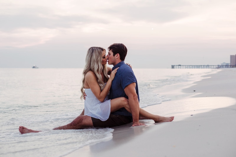 Couples Photography Jacksonville Beach Florida, couple sitting in the water at beach