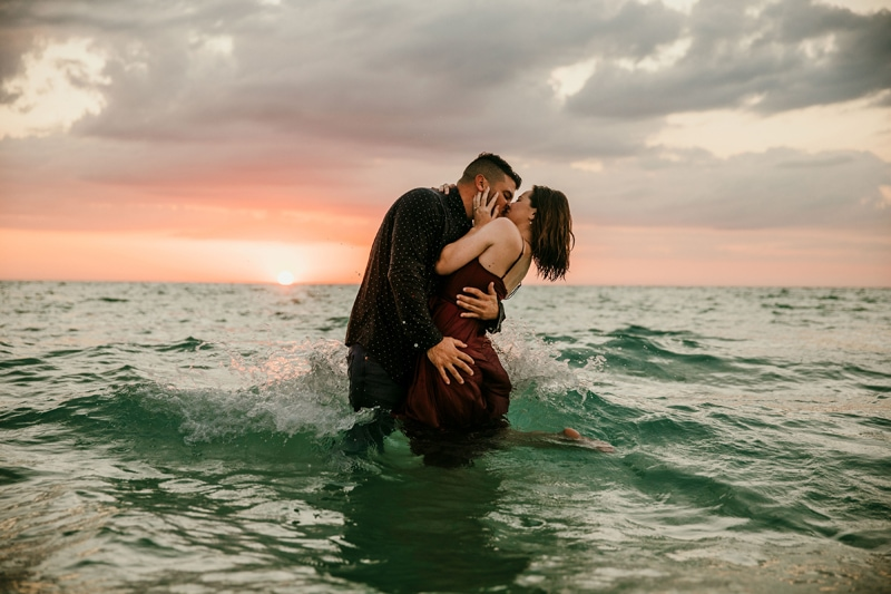 Couples Photography, Couple kissing in the water at beach